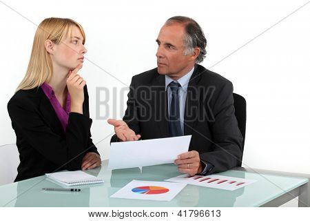 Businesspeople going over statistical data