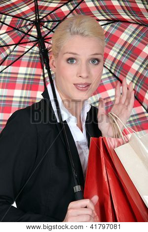 Female shopper under a brolly