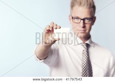 Friendly businessman presenting white empty business card with space for text, isolated.