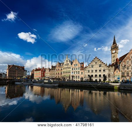 Europe Belgium medieval town travel background - Ghent canal and Graslei street on sunset. Ghent, Belgium