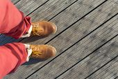 stock photo of platform shoes  - Shoes from an aerial view on wooden background - JPG
