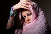 stock photo of hijabs  - woman with blue eyes in pink hijab looks in camera - JPG