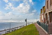stock photo of gare  - Houses looking over the frozen sea in the Netherlands - JPG