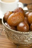 picture of milkmaid  - indian special sweet Gulab Jamun - JPG