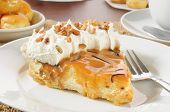 picture of cream puff  - A slice of cream pie with caramel whipped cream and nuts - JPG