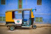 image of rickshaw  - Traditional motorized rickshaw againsta a blue wall in Jodhpur Rajasthan India - JPG