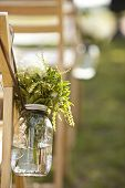stock photo of mason  - detail from wedding of bouquet in mason jar - JPG