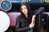 picture of youg  - Youg pretty brunette girl leaning on to the vintage locomotive - JPG