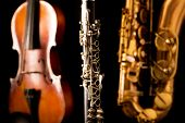 stock photo of sax  - Music Sax tenor saxophone violin and clarinet in black background - JPG