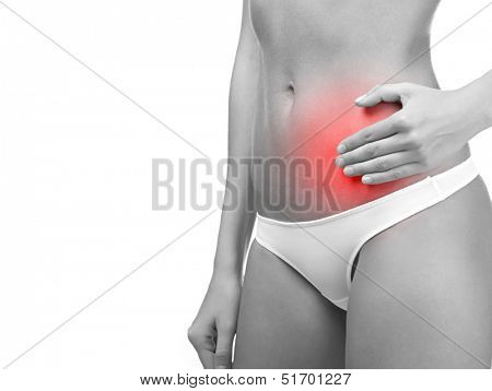 Acute pain in a woman belly. Female holding hand to spot of belly ache. Concept photo with red spot indicating location of the pain. Isolation on white background.