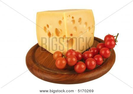 Big Chunk Of Yellow Cheese And Tomatoes