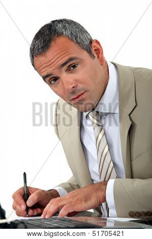 Attentive businessman making notes
