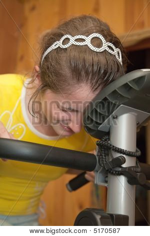 Weariness Girl On Exercycle