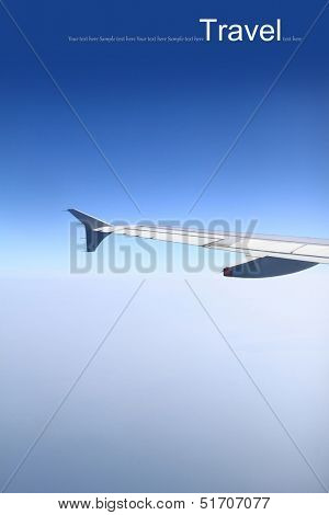 Blue horizon, aerial shot from airplane with wing visible
