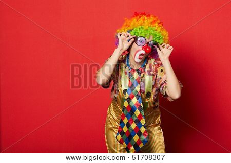 funny clown with glasses on red