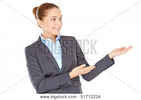 Beautiful elegant professional woman pointing to the side with her hands as she invites you to view something to the right of the frame  isolated on white
