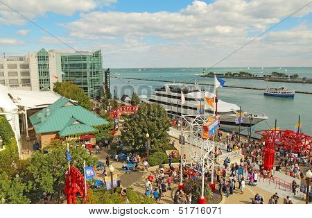Tourists And Boats At Navy Pier In Chicago, Illinois