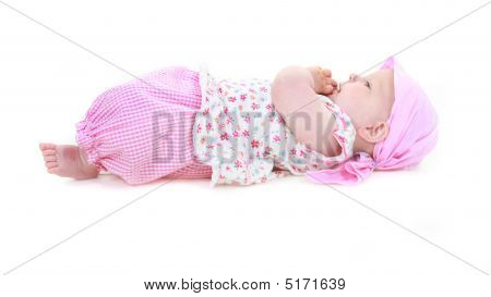 Cute Baby Girl In Pink Over White
