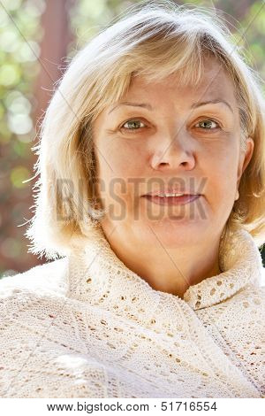 Portrait Of A Smiling Middle Age Woman