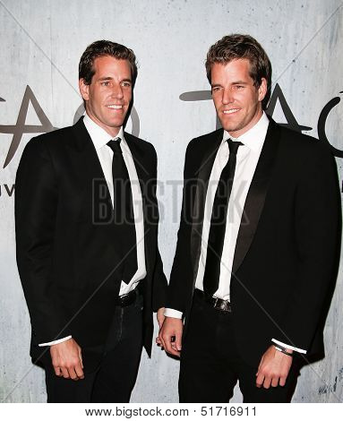 NEW YORK-SEP 28: Cameron (L) and Tyler Winklevoss attends the grand opening of TAO Downtown at the Maritime Hotel on September 28, 2013 in New York City.