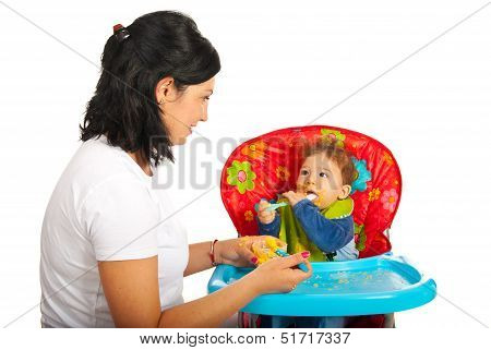 Mother Giving Puree To Her Baby