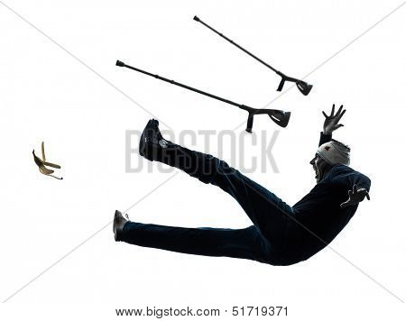 one  man injured man with crutches slipping in silhouette studio  on white background