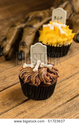 Werewolf Hand Creepily Reaching For A Halloween Cupcake