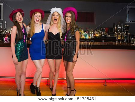 Laughing friends having a hen party and looking at camera