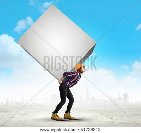 Image of woman engineer in helmet carrying burden on back