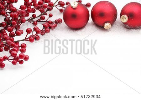 Christmas balls and berries on white background
