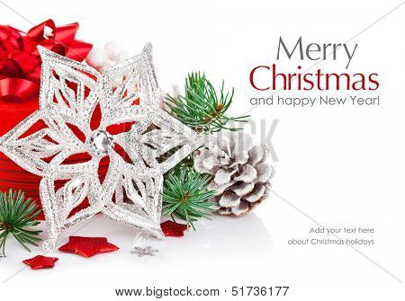 christmas tinsel with branch firtree and red gift isolated on white background