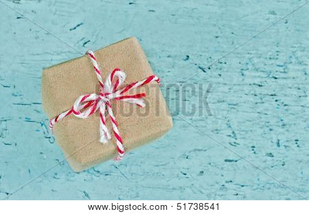 Gift Box Wrapped In Brown Paper With Red Striped String