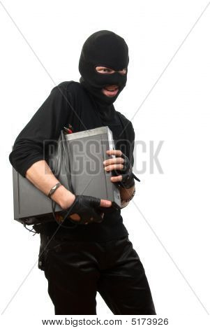 Robber In A Mask With Device In Hands