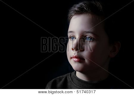 Thoughtful Young Boy In A Lowkey Portrait