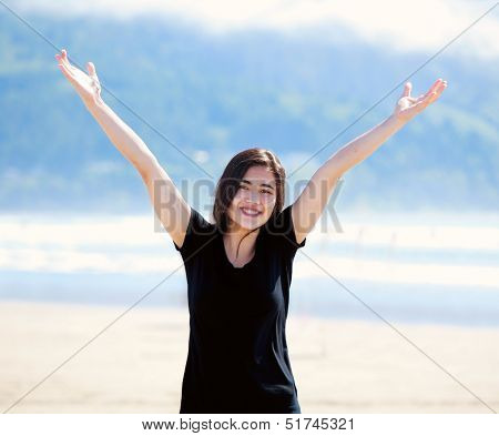 Happy Young Woman On Beach, Arms Outstretched