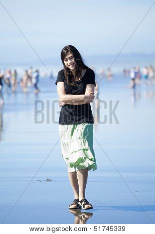 Beautiful Biracial Young Woman Or Teen Walking Along Beach By Pacific Ocean
