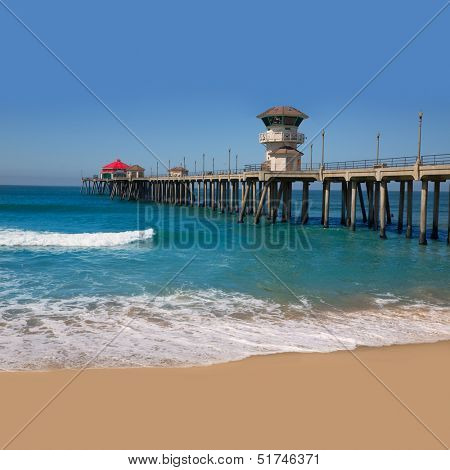 Huntington beach Surf City USA pier view with sand and waves