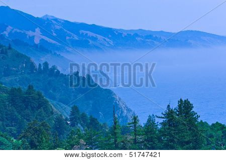 Pacific Ocean Bay In A Blue Fog Mist.