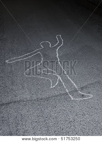 Contour of a person drawn at the asphalt
