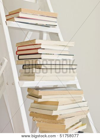 Pile of books on a ladder
