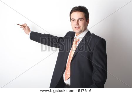 White Business Man Pointing At Blank Space