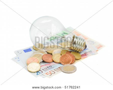 common lamp bulb on euro money