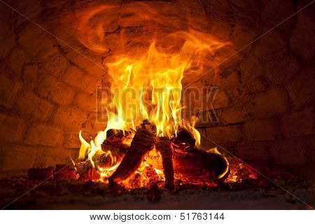 Flaming Bonfire in front of brick wall