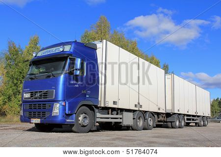 Blue Volvo Truck With Full Trailer