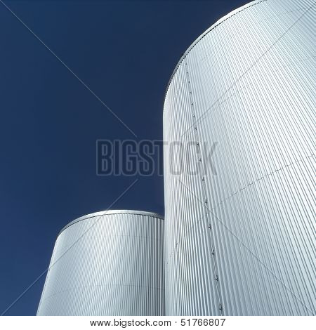 Storage Tanks in front of blue sky