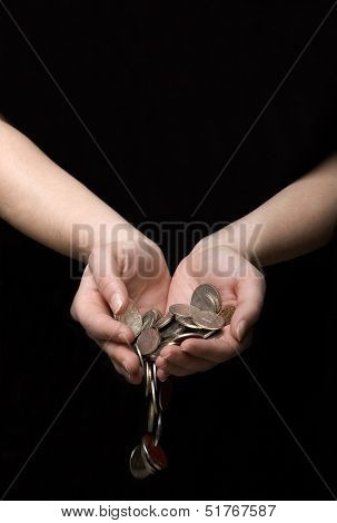Coins flowing out of hands