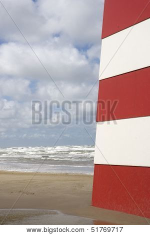 Red and White Landmark on the beach