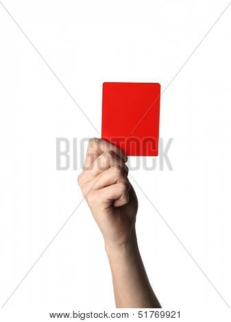 Hand holding up the Red Card isolated on white