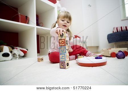 Baby girl playing in her room