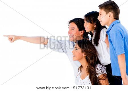 Happy family portrait pointing away - isolated over a white background